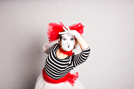 Portrait of a comedian  woman dressed up as a mime, April Fools Day concept.