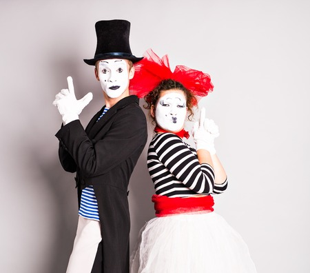simulate: Street artists performing, Two mimes man and  woman in april fools day