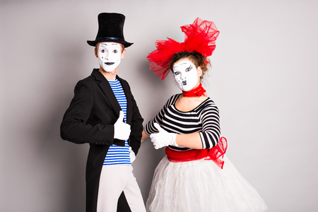 comedian: Portrait of a two happy mimes comedian showing thumbs up, April Fools Day concept.