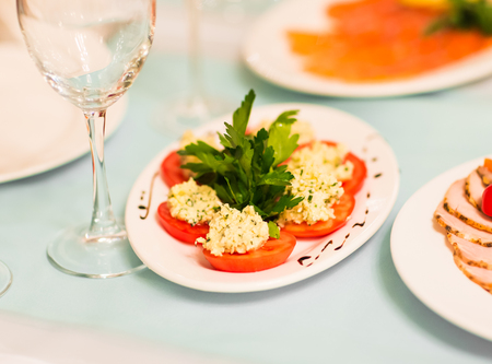 balsamic: Plate with Tomato and cheese with Balsamic Vinegar. Stock Photo