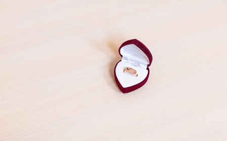 wedding accessories: gold wedding rings on the table. Wedding accessories