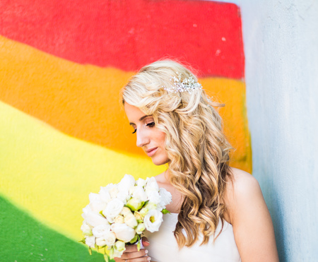 wedding hairstyle: Beautiful bride with fashion wedding hairstyle outdoors.