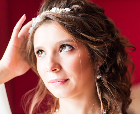 wedding hairstyle: Beautiful young bride with fashion wedding hairstyle.