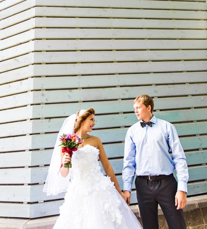 wedlock: Bride and groom holding hands outdoors. Wedding, newlywed