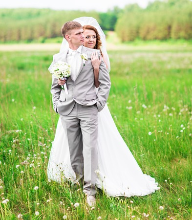 embraced: Just married couple embraced. Bridegroom, wedding couple