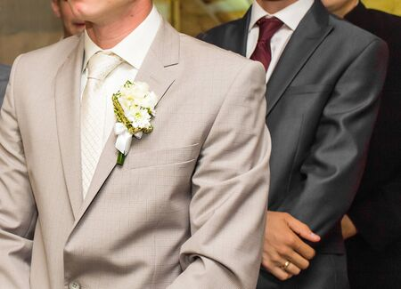 young  cuffs: Very beautiful buttonholes on the jacket of a young and handsome groom.