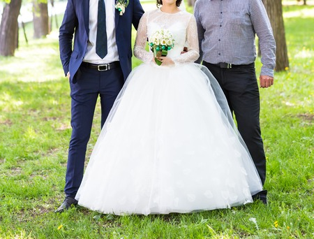 guests: The bride and groom, and guests in a park