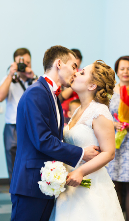 newly married: First kiss of newly married couple , wedding ceremony