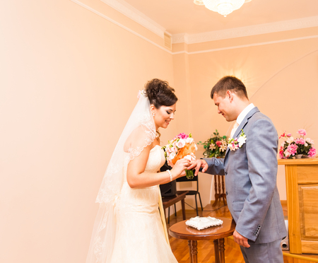 registry: wedding ceremony in a registry office painting, marriage Stock Photo