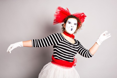 mime: Portrait of a dancing woman mime. Woman mime
