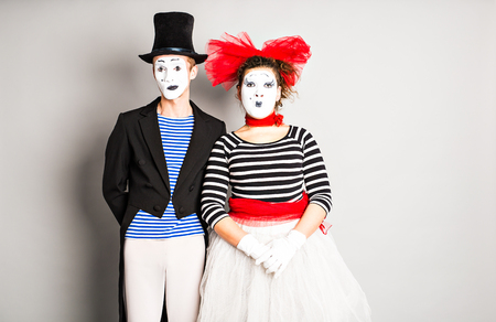 simulate: Street artists performing, Two mimes man and  woman in april fools day.