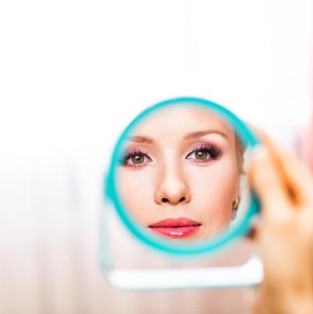 reflexion: beautiful pretty young woman reflexion in mirror. Stock Photo