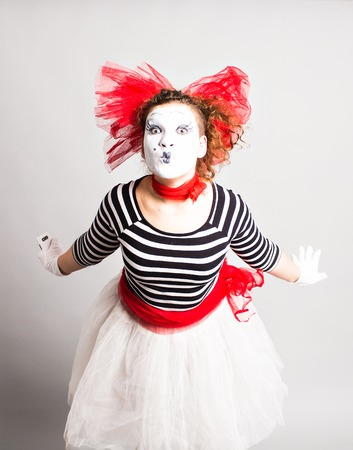 mime: Portrait of the woman as mime sending a kiss. Concept of love and April Fools Day