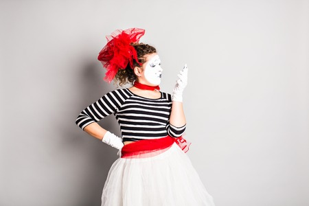 ballyhoo: mime with smartphone. Concept of april fools day