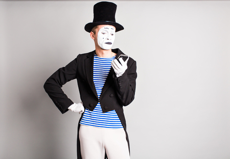 mime: mime with smartphone. Concept of  April Fools Day