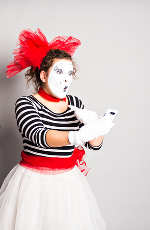 mime: mime with smartphone. Concept of April Fools Day Stock Photo