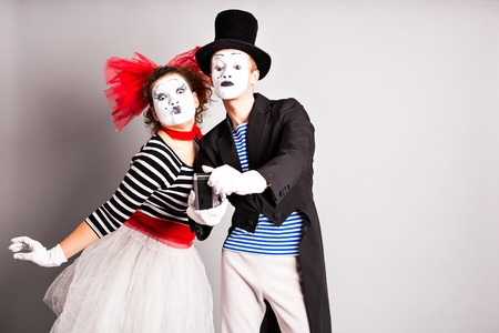 capture the moment: Funny couple of mimes taking a selfie photo,  April Fools Day.