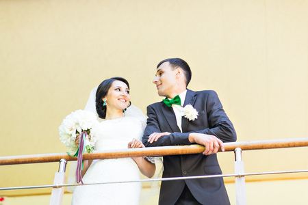 butonniere: Happy bride and groom on their  wedding.