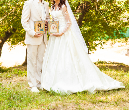 Bride and groom after  orthodox wedding ceremony, wedding couple  with icons