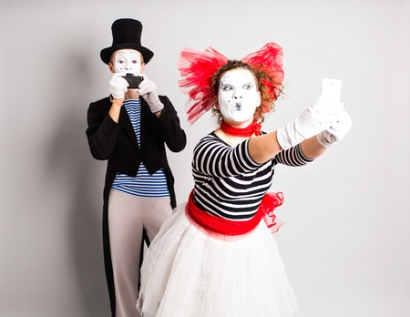 I love selfie. Mime holding camera and making selfie