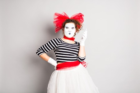 mime: Beautiful woman mime talking on her cell phone Stock Photo
