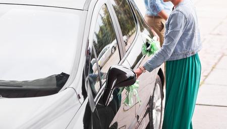 open car door: Open car door - new car. Woman  open car