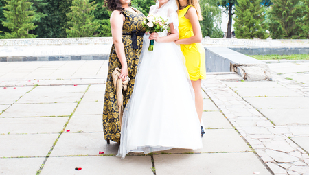 bridesmaids: Stylish bridesmaids have fun with bride outdoors