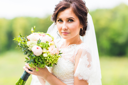 20 24: Stunning young beautiful bride holding bouquet, portrait