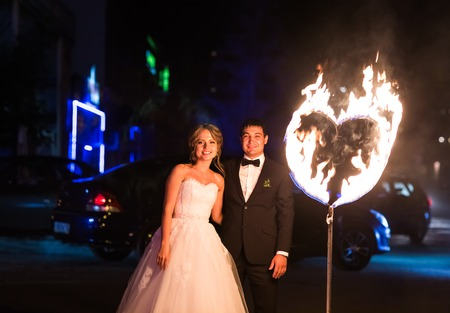 hands fire passion: set fire to the couple on their wedding heart. Stock Photo