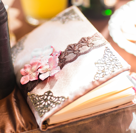 wedding wish book decorated with flowers and lace. Stock Photo