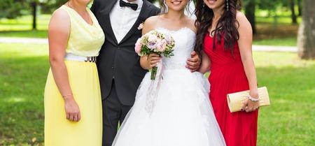 bridesmaids: Family Group At Wedding. Bridesmaids and friends