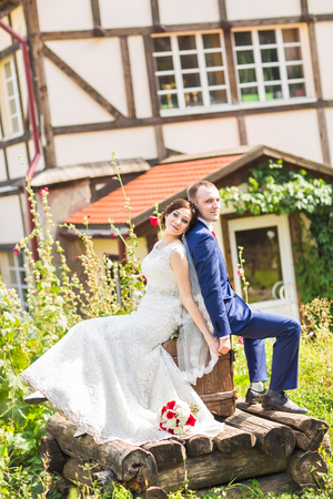 butonniere: Happy bride and groom on their  wedding day