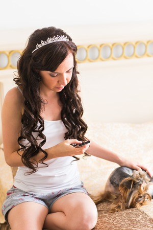 yorkie: Cute young girl with her Yorkie puppy. Stock Photo