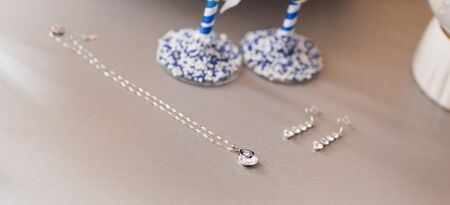 earrings: Beautiful Silver jewelry chain with pendant and earrings for woman Stock Photo