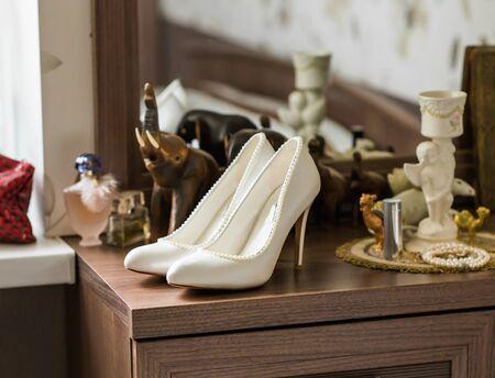 opentoe: white wedding shoes on the wood background
