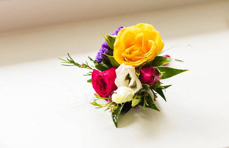 buttonhole: Gentle grooms boutonniere. Different grooms accessories and buttonhole