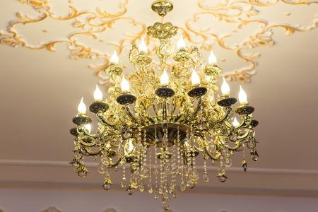lustre: beautiful crystal chandelier in a room. lamp