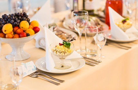 napkin: Served for a banquet table. Wine glasses with napkins, plate and salads