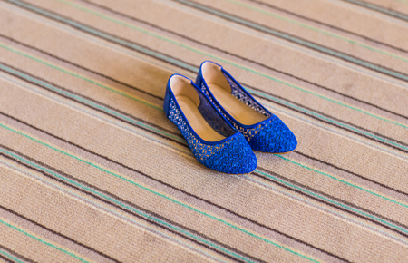 flat shoes: Elegant blue flat shoes for women in stones Stock Photo