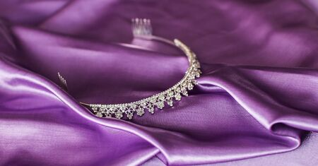 diadem: Close-up of silver diadem on purple background