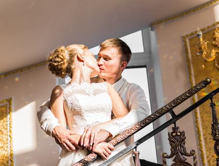 fondling: Kiss the bride and groom. Wedding couple Stock Photo