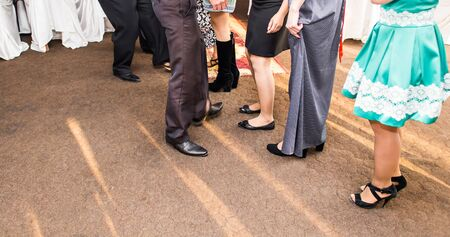 social behaviour: feet of people dancing on a club party. unrecognizable.