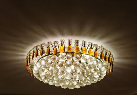 crystal chandelier: Chrystal chandelier close-up. Glamour. crystal chandelier in the interior Stock Photo