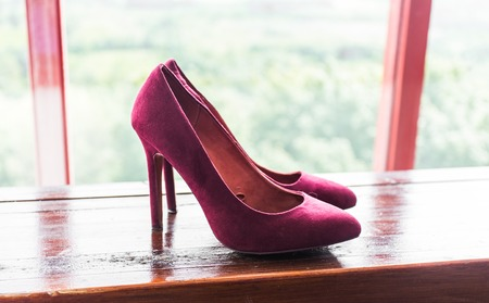 Legs and heels: Close up of a pink high heels shoes.