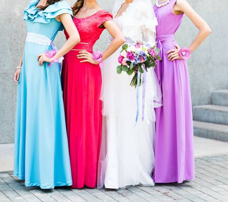 elegant party: Bride with bridesmaids on the park on the wedding day