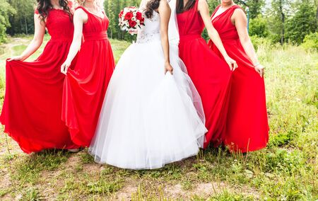 bridesmaids: Bride with bridesmaids on the park on the wedding day