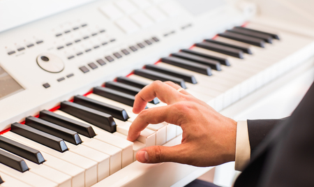 pianist: Hands of musician. Pianist playing on electric piano