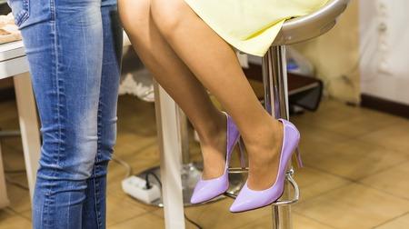 purple shoes: woman legs in purple high heel shoes indoors.