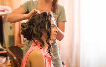 stylist: Hair stylist makes the bride before the wedding Stock Photo