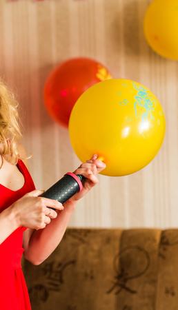air pump: Air pump and balloon indoors. holidays decor Stock Photo